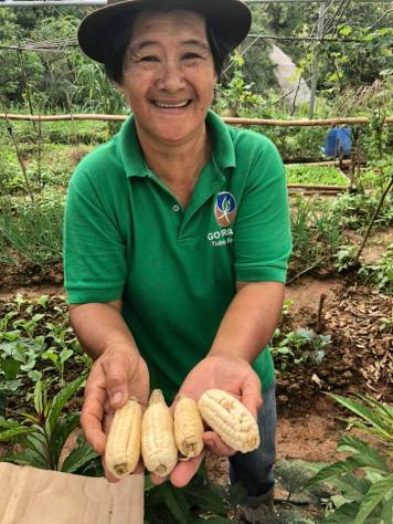 BASS Farmer Mary poses proudly with her native corn.