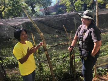 BASS Member Fely describing her coffee production with our Country Manager Karen.